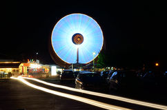 Ferris wheels in motion at night Royalty Free Stock Photo