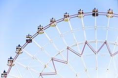 Ferris whell. Ferris wheel on a blue background Royalty Free Stock Photos