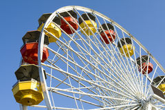 Ferriswheel. In amustment park against sunny, blue sky Royalty Free Stock Images