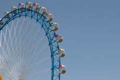 Ferriswheel with blue sky. Blue ferriswheel in front of blue sky on a sunny day Royalty Free Stock Photo