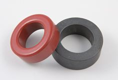 Ferrite core. Ferrite and powdered iron cores for use in electronic transformers or coils Stock Photos