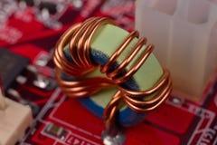Ferrite ring on circuit board Stock Photos