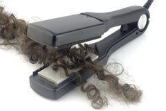 Ferro e fechamento do cabelo Foto de Stock Royalty Free