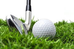 Ferro e sfera di golf Fotografia Stock