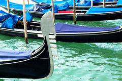 Ferro of gondola docked on the venetian lagoon Royalty Free Stock Photos