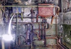 Ferro oxidado de uma comunicação das tubulações muito velho Fotografia de Stock