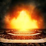 Ferrocarril en puesta del sol dramática roja Imagen de archivo