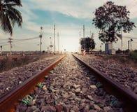 Ferrocarril a la puesta del sol Imagen de archivo libre de regalías