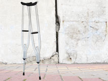 Ferroconcrete wall and and crutches Stock Photos