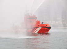 FERROL, SPAIN - FEBRUARY 15: Spanish Sea rescue tug on February. 15 , 2013, in Ferrol, Spain. This tug is pouring water over the entrance to the ship Juan Stock Images