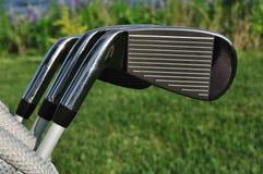Ferros em um saco de golfe Fotos de Stock Royalty Free