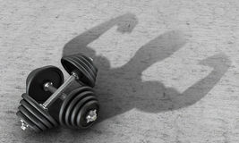 Ferrous metal dumbbell human silhouette casts. A shadow on the concrete.3D illustration Stock Images