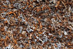 Ferrous metal. Pieces of ferrous metal from magnetic separation of shredded cars Stock Image