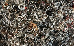Ferrous of scraped metals, metal shavings at the workshop. Close-up image of round shape scraped metals, metal shavings at the workshop royalty free stock photos
