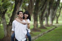 Ferroutage asiatique de couples Photographie stock libre de droits