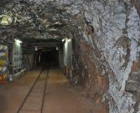 Ferrovia della miniera in sotterraneo Fotografie Stock