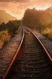 Ferrovia nel tramonto Immagini Stock
