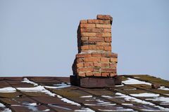 Ferruginous roof and old flue Royalty Free Stock Photos