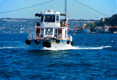 Ferry. A ferry boat on bosporus with bridge in background Stock Photos