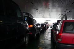 On the ferry. Cars in line on a fjord crossing ferry in Norway Royalty Free Stock Photography
