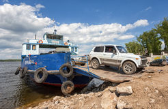 Ferry across Volga river in summertime Stock Images