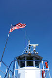 Ferry Aft of the Cockpit. This is the aft rear side of the cockpit or bridge of the champlain ferry wich crosses between New York and Vermont. Two American flags Stock Photos