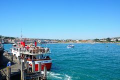 Ferry along pier, Swanage. Stock Photography