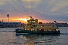 Ferry and amazing sunset Stock Photos