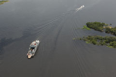 Ferry on the Amazon seen from plane stock photo