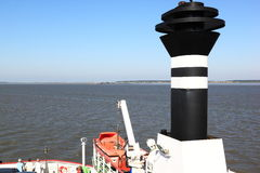 Ferry approaches Ameland Island, Netherlands Stock Photography