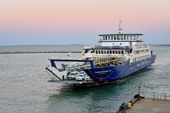 The ferry approaching the dock in Kerch at sunset. Crimea Royalty Free Stock Images