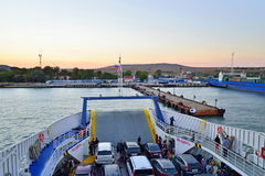 The ferry approaching the dock in Kerch at sunset. Crimea Royalty Free Stock Image