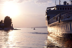 Ferry approching Dalmatian coast on sunset Stock Photography