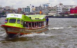 Ferry arrives to the pier, Bangkok, Thailand Royalty Free Stock Photography