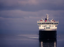 Ferry Arriving At Dusk. Passenger Ferry Crossing Sea At Dusk Royalty Free Stock Images