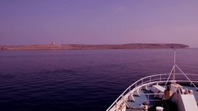 Ferry arriving to the port in Gozo stock video footage