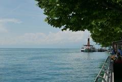 Ferry arriving at Vevey. Vevey on Lake Geneva stock image