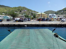 A ferry backing up to the bequia jetty. Royalty Free Stock Image