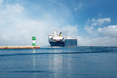 Ferry on the Baltic Sea. With green Lighthouse Royalty Free Stock Photo