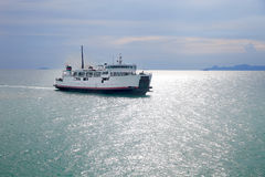 Ferry in the blue sea Stock Image