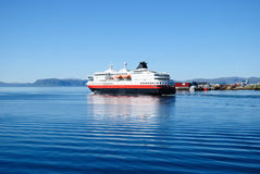 Ferry on blue water of Norwegian fjord. Stock Photos