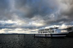Ferry boat anchored in Lake Champlain on cloudy day. Burlington, Vermont stock image