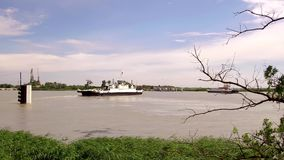 Ferry Boat crosses the Rhone river in France. Ferry Boat carrying vehicles and tourists crosses the Rhone in France, French Camargue, video 4K stock video