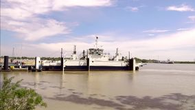 Ferry Boat crosses the Rhone river in France. Ferry Boat carrying vehicles and tourists crosses the Rhone in France, French Camargue, video 4K stock video footage