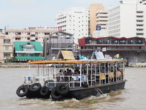 Ferry boat crossing CHAO PHRAYA river in BANGKOK THAILAND Stock Images
