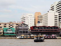 Ferry boat crossing CHAO PHRAYA river in BANGKOK THAILAND Stock Photography