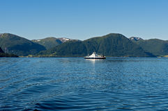 Ferry boat crossing a fjord Royalty Free Stock Photo