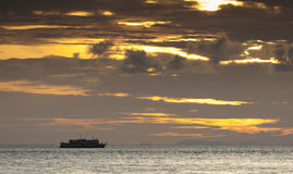 A Ferry Boat Cruising the Indonesian Archipelago at Sunset Royalty Free Stock Photo