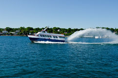 Ferry boat cruising on the lake Stock Photo