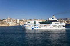 Ferry boat cruising into old port and third largest city in France, Marseille, Provence, France on the Mediterranean Sea Royalty Free Stock Photography